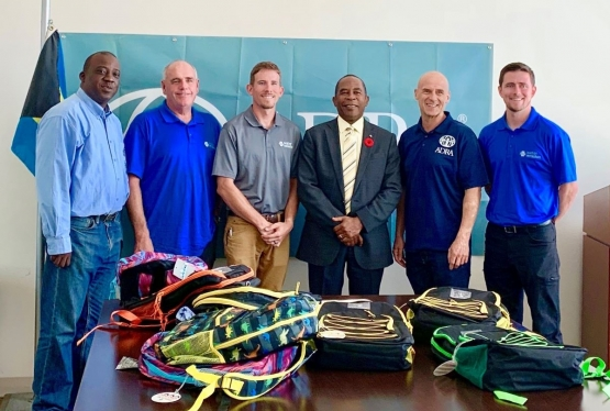 Representatives from ADRA and its partner, Water Mission, pose with Grand Bahama's Superintendent of Education (pictured third f