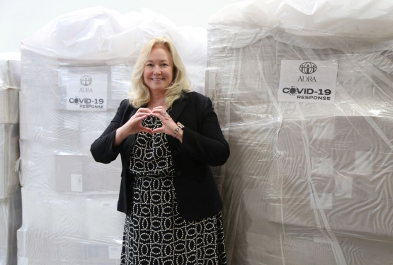 Senior Vice President for Advancement Rachelle Bussell expresses appreciation to ADRA with a heart-shaped hand sign