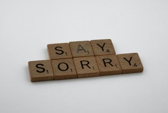 "Scrabble tiles spelling ""say sorry"""